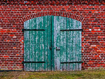 Old wooden gate in brick house. Old wooden gate in the brick house Royalty Free Stock Photos