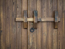 Old wooden gate closed with a big bolt Royalty Free Stock Images