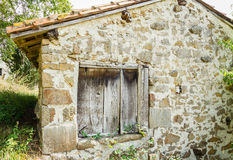 Old wooden gate closed in stone house Royalty Free Stock Photos