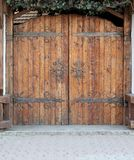 Old wooden gate. S with metal hinges Royalty Free Stock Photos