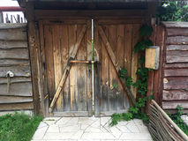 Old wooden gate in the house which is in a rural location Stock Photos