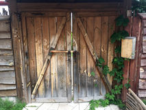 Old wooden gate in the house which is in a rural location Royalty Free Stock Photography