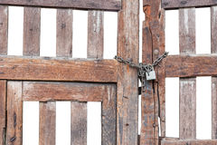 Old wooden gate with lock and chain isolated on white Royalty Free Stock Photo