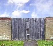 Old  wooden gate with metal lock Stock Photos