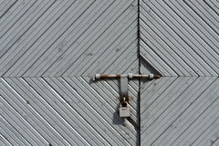 Old wooden gate with metal padlock. Royalty Free Stock Photos