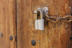 Old wooden gate with padlock Stock Photos