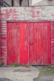 Old wooden gate in a red brick wall Stock Photo