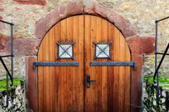 Old wooden gate to the dungeon in a castle ruin.  stock photo