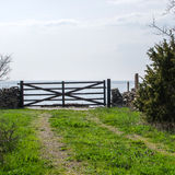 Old wooden gate to the water Stock Photography