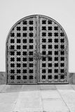 Old wooden gate in the wall of a building black and white Stock Images