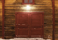 Old wooden gate of warehouse with spotlight Royalty Free Stock Photos