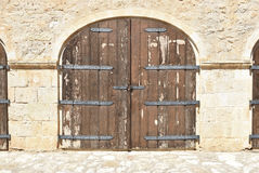 Old wooden gates in Rethymnon. Royalty Free Stock Photo
