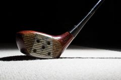 Old wooden Golf Club. On a carpet Stock Photo