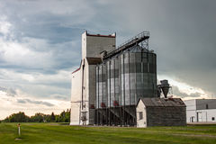 Old Wooden Grain Elevator Against Dramatic Sky Royalty Free Stock Photography