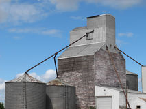 Old wooden grain elevator complex. Royalty Free Stock Image