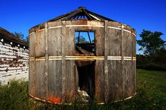 Old Wooden Granary on the Prairie. Old wooden Granary stands abandoned on the prairies in Canada stock photo