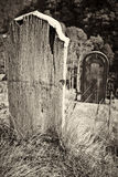 Old wooden grave headstone Stock Images