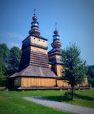 Old wooden Greek orthodox church. Beautiful wooden Greek orthodox church in Kotan in podkarpackie region in southern Poland sorrounded by old trees. Built in Royalty Free Stock Image