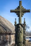 An old wooden green cross on a blue sky royalty free stock photos