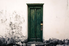 Old wooden green door. Antique wooden green door have padlock royalty free stock image