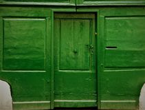 Old wooden green door to a house in Transylvania, Romania royalty free stock photo