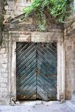 Old wooden green doors in Montenegro in Kotor. A street of the Old Town of Kotor. The old part of Kotor is a UNESCO World Heritage site and a famous tourist royalty free stock photography