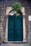 Old wooden green doors in Montenegro. In Kotor royalty free stock image