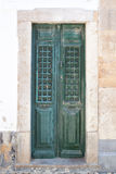Old wooden green doors on the streets. Royalty Free Stock Photography