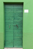 Old wooden green locked door Royalty Free Stock Image