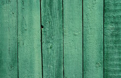 Old wooden green painted fence, beautiful background Royalty Free Stock Photo
