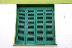 Old wooden green window with shutters. royalty free stock images