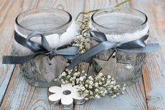 Old wooden grey shelves with grey white Christmas  wooden decoration. Such as flowers, heart shape and star and candles holder decorated with baby's breath Royalty Free Stock Image