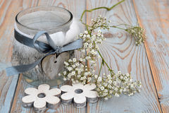 Old wooden grey shelves with grey white Christmas  wooden decoration. Such as  heart shape and flowers and candles holder decorated with baby's breath flowers Royalty Free Stock Images