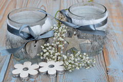 Old wooden grey shelves with grey white Christmas  wooden decoration. Such as  heart shape , star and flowers and candles holder decorated with baby's breath Stock Images