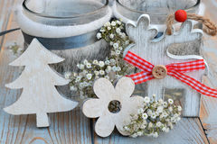 Old wooden grey shelves with grey white Christmas  wooden decoration. Such as  reindeer, christmas tree,heart shape , star and flowers and candles holder Royalty Free Stock Photography