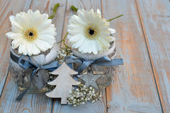 Old wooden grey shelves with grey white Christmas  wooden decoration. Such as christmas tree, heart shape and star and candles holder decorated with baby's Stock Photography