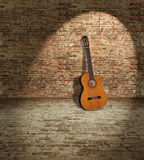 Guitar and wall Stock Photography