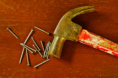 Old wooden hammer and square nails Stock Photo