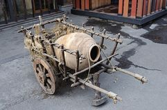 Old wooden handcart with big pitcher Royalty Free Stock Image