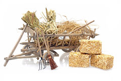 Old wooden handcart full of straw Stock Photos