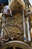 Old wooden handcart full of straw and agricultural tools. Close-up royalty free stock photography
