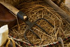 Old wooden handcart full of straw and agricultural tools. Close-up royalty free stock photo