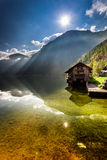 Old wooden haven at mountain lake Stock Image