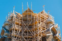 Old wooden 22-head Orthodox Church of the Transfiguration during the restoration. The church is one of the best examples of world. Folk architecture, built in stock photos