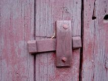 Old wooden for hinge red purple lime paint royalty free stock photography