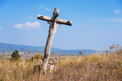 Old wooden holy cross, over the blue sky. Old abandoned wooden holy cross, over the blue sky Royalty Free Stock Photo