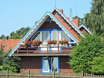 Old wooden home. Red wooden home  in Nida , Lithuania Royalty Free Stock Photography