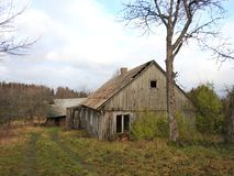 Old wooden home in village, Lithuania. Old wooden home ruins in village in autumn royalty free stock photos