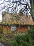 Old wooden home in village, Lithuania. Old uninhabitable home in village Minge in spring stock photo