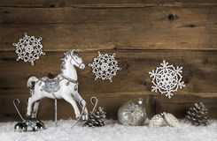 Old wooden horse on a background with snow. Nostalgic christmas Stock Photography
